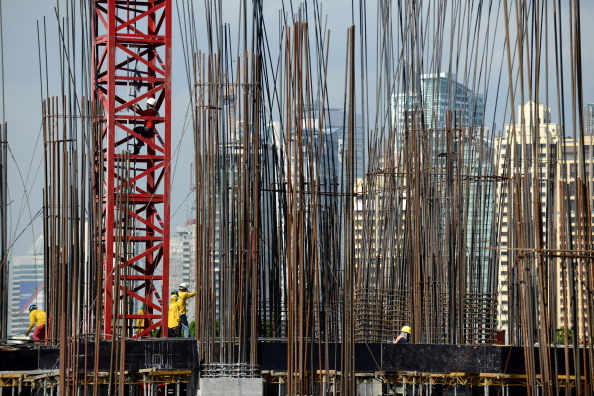Employees work at a construction site in Manila on November 28, 2012. The Philippines said on November 28 that the economy expanded a better-than-expected 7.1 percent year on year in the three-months to September on the back of a robust services sector.  AFP PHOTO / NOEL CELIS        (Photo credit should read NOEL CELIS/AFP/Getty Images)